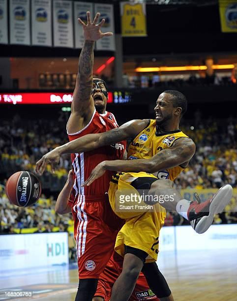 Lawrence Roberts of Muenchen is challenged by Je Kel Foster of Berlin during the second leg of the playoff match between ALBA Berlin and FC Bayern...