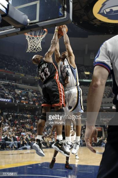 Lawrence Roberts of the Memphis Grizzlies is blocked by Alonzo Mourning of the Miami Heat on December 2, 2006 at FedExForum in Memphis, Tennessee....