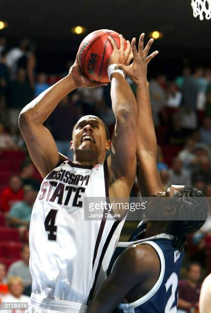 Lawrence Roberts of the Mississippi State Bulldogs shoots over Anthony Myles of the Xavier Muskateers during the second round game of the NCAA...