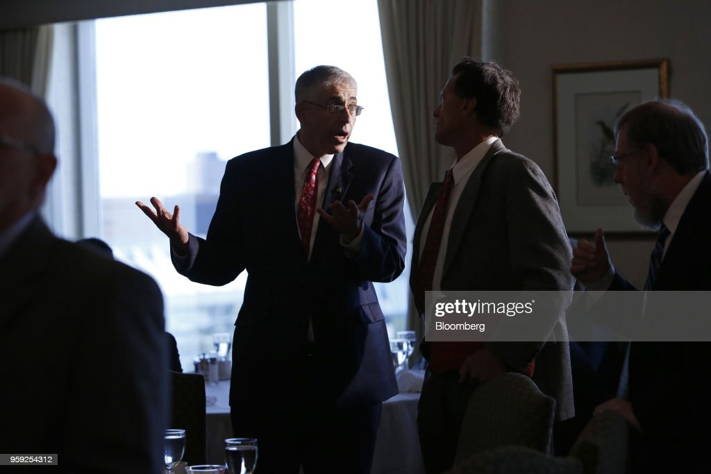Lawrence Schembri, deputy governor of the Bank of Canada, speaks to an attendee following his speech to the CFA Society Ottawa and Ottawa Economics Association at the Rideau Club in Ottawa, Ontario, Canada on Wednesday, May 16, 2018. Schembri said the current economic expansion is helping to repair damage caused by the last recession on the nations productive capacity. Photographer: David Kawai/Bloomberg via Getty Images
