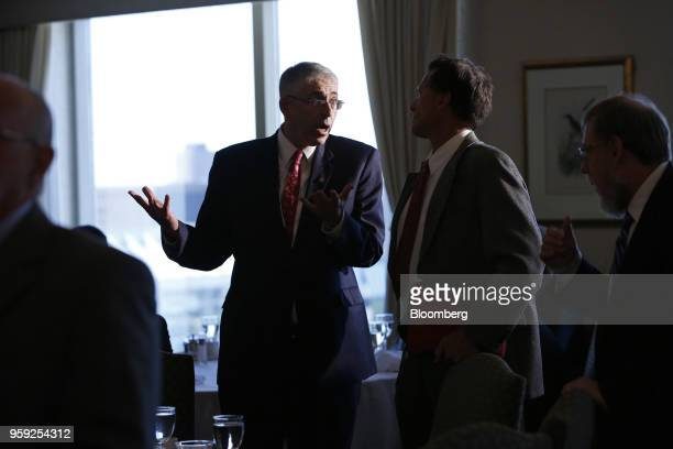 Lawrence Schembri deputy governor of the Bank of Canada speaks to an attendee following his speech to the CFA Society Ottawa and Ottawa Economics...