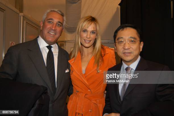 Lawrence Stroll Molly Sims and Cylus Chou attend Michael Kors fashion show at at the tents on February 11 2004 in New York City