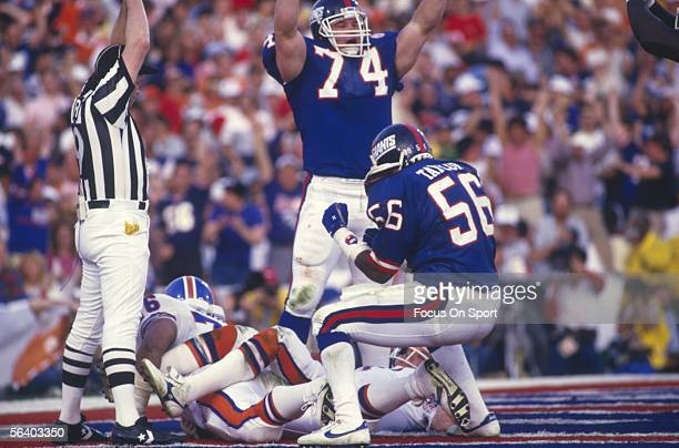 Lawrence Taylor of the New York Giants celebrates after two Denver Broncos players failed to stop a touchdown during Super Bowl XXI at the Rose Bowl...