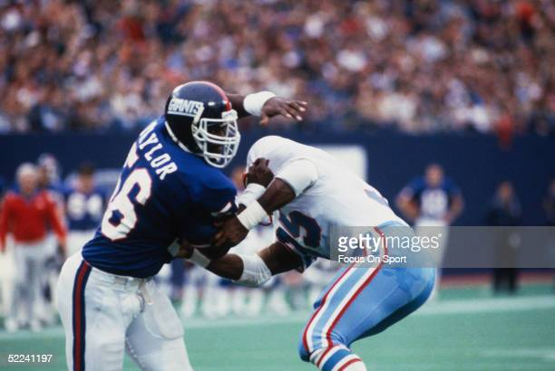 Lawrence Taylor of the New York Giants pass rushes against the Houston Oilers during a circa 1980s game at Giants Stadium in East Rutherford New...