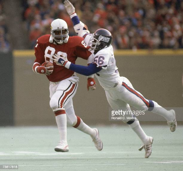 Lawrence Taylor of the New York Giants tackles Chris Combs of he St Louis Cardinals on December 13 1981 in St Louis Cardinals