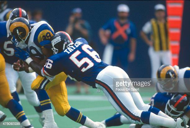 Lawrence Taylor of the New York Giants tackles Robert Delpino of the Los Angeles Rams during an NFL football game September 8 1991 at The Meadowlands...