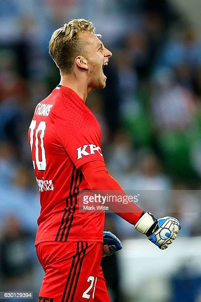 Lawrence Thomas of Melbourne Victory celebrates after the game during the round 11 ALeague match between Melbourne City FC and Melbourne Victory at...