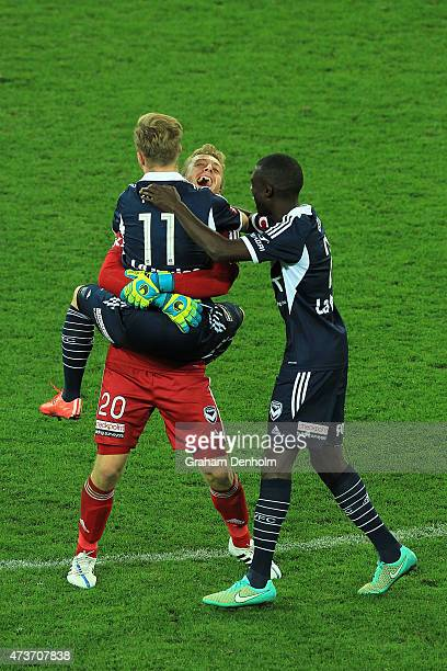 Lawrence Thomas of Melbourne Victory embraces Connor Pain after winning the 2015 ALeague Grand Final match between the Melbourne Victory and Sydney...