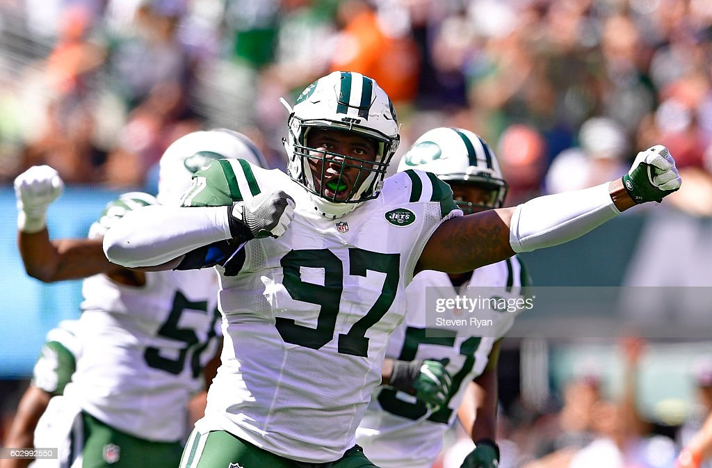 Lawrence Thomas #97 of the New York Jets celebrates after making a tackle on a punt return by the Cincinnati Bengals during the second quarter at MetLife Stadium on September 11, 2016 in East Rutherford, New Jersey. The Cincinnati Bengals defeated the New York Jets 23-22.