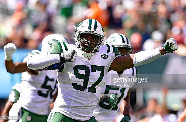 Lawrence Thomas of the New York Jets celebrates after making a tackle on a punt return by the Cincinnati Bengals during the second quarter at MetLife...