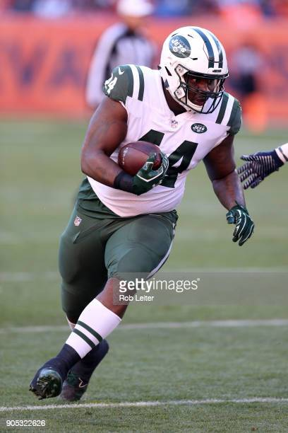 Lawrence Thomas of the New York Jets runs with the ball during the game against the Denver Broncos at Sports Authority Field At Mile High on December...