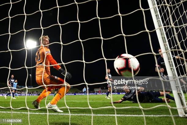 Lawrence Thomas of the Victory attempts to stop a goal by Adam Le Fondre of Sydney FC during the A-League Semi Final match between Sydney FC and the...