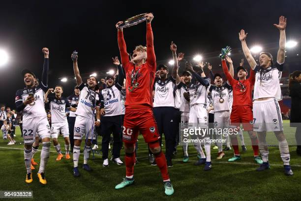 Lawrence Thomas of the Victory celebrates with team mates after winning the 2018 ALeague Grand Final match between the Newcastle Jets and the...