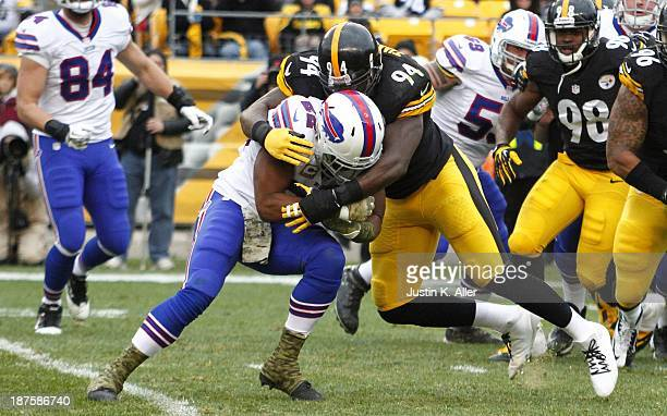Lawrence Timmons of the Pittsburgh Steelers tackles Fred Jackson of the Buffalo Bills during the game on November 10 2013 at Heinz Field in...