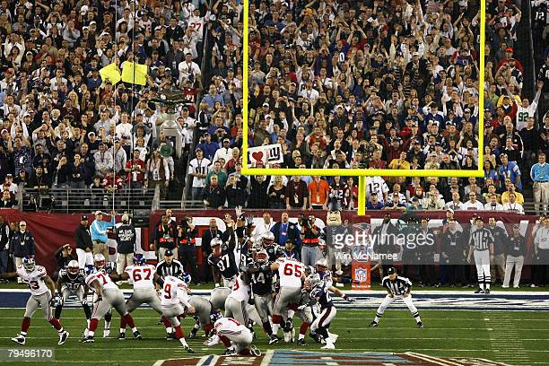 Lawrence Tynes of the New York Giants kicks a 32-yard field goal during the first quarter against the New England Patriots during Super Bowl XLII on...