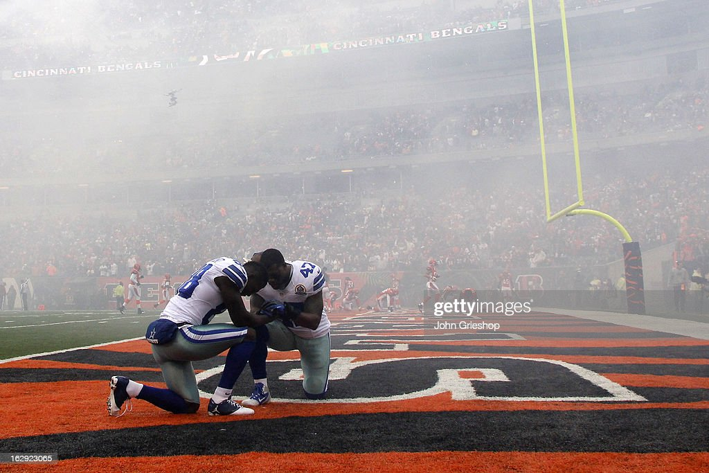 Lawrence Vickers And Dez Bryant Of The Dallas Cowboys Pray