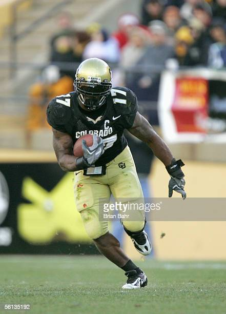 Lawrence Vickers of the Colorado Buffaloes carries the ball during the game against the Missouri Tigers on October 5, 2005 at Folsom Field in...
