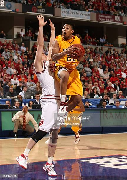 Lawrence Westbrook of the Minnesota Golden Gophers drives for a shot attempt against Kyle Taber of the Indiana Hoosiers during the Big Ten Men's...