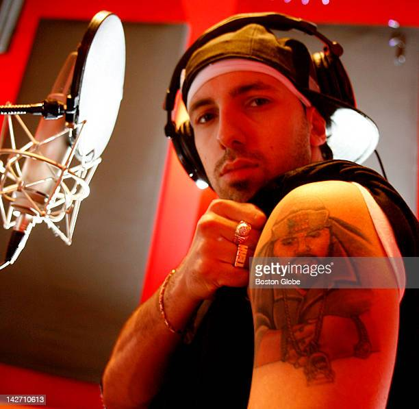 Lawrencebased hip hop artist Termanology shows his tattoo of rap star Big Pun in the Wanka Sound Recording Studio in Lowell Mass as he works on his...