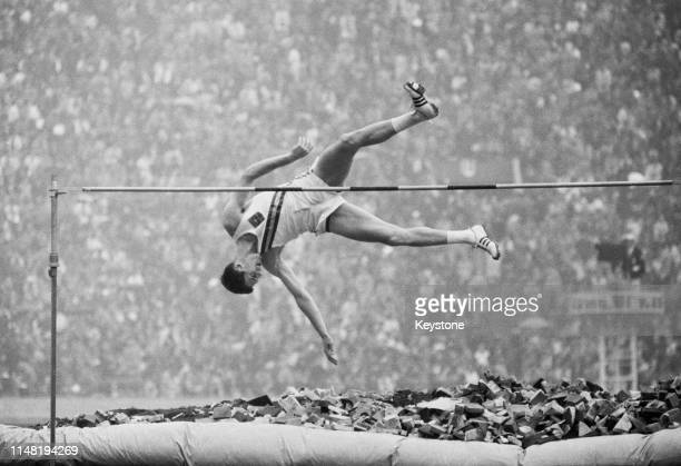 Lawrie Peckham of Australia competes in the Men's High Jump competition on 21st October 1964 during the XVIII Summer Olympic Games at the National...
