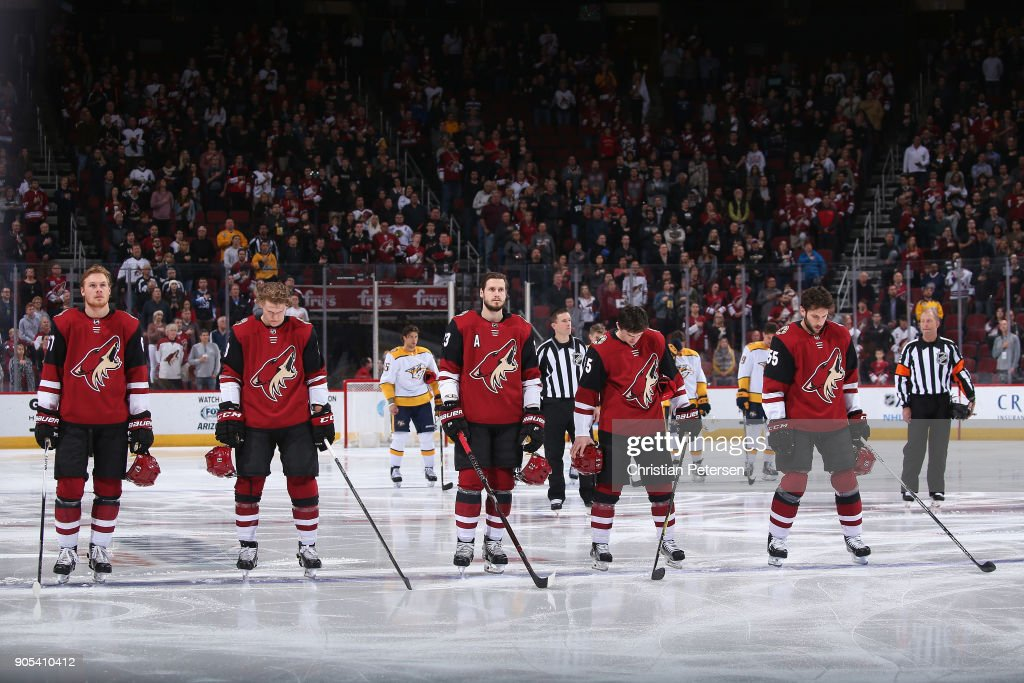 Lawson Crouse #67, Christian Dvorak #18, Oliver Ekman-Larsson #23, Josh Archibald #45 and Jason Demers #55 of the Arizona Coyotes stand attended for the national anthem before the NHL game against the Nashville Predators at Gila River Arena on January 4, 2018 in Glendale, Arizona. The Coyotes defeated the Predators 3-2 in overtime.