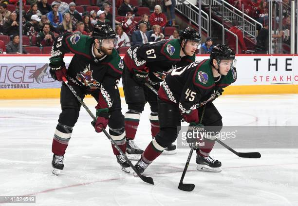 Lawson Crouse Josh Archibald and Alex Goligoski of the Arizona Coyotes get ready during a faceoff against the Winnipeg Jets at Gila River Arena on...