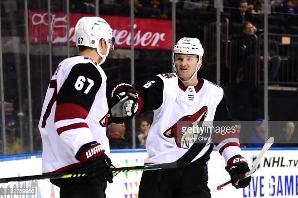 Lawson Crouse of the Arizona Coyotes celebrates with Christian Fischer after Crouse's first period goal during their game against the New York...