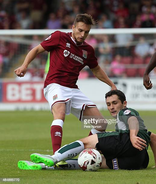 Lawson D'Ath of Northampton Town contests the ball with Carl McHugh of Plymouth Argyle during the Sky Bet League Two match between Northampton Town...