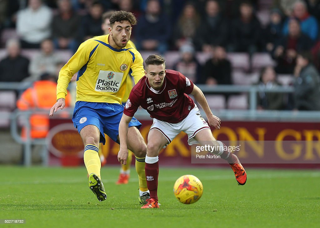 Lawson D'Ath of Northampton Town looks to the ball with Matt Crooks of Accrington Stanley during the Sky Bet League Two match between Northampton Town and Accrington Stanley at Sixfields Stadium on December 28, 2015 in Northampton, England.