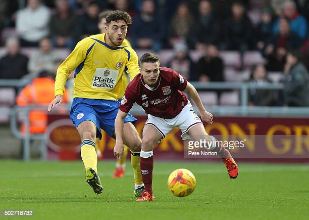 Lawson D'Ath of Northampton Town looks to the ball with Matt Crooks of Accrington Stanley during the Sky Bet League Two match between Northampton...