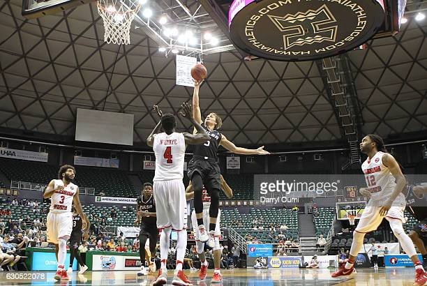 Lawson Korita of the Tulsa Golden Hurricane takes a shot over Daouda Ndiaye of the Illinois State Redbirds during the second half of the Diamond Head...