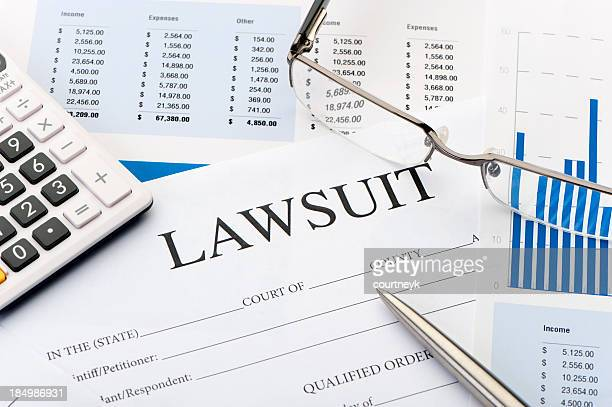 lawsuit form an a desk - lawsuit stock pictures, royalty-free photos & images