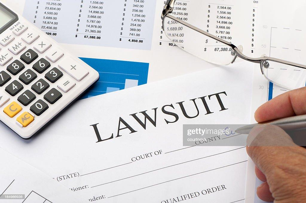 Lawsuit form an a desk : Stock Photo
