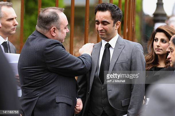 Lawyer Aamer Anwar is consoled by First Minister Alex Salmond following the funeral of QC Paul McBride St Aloysius Church on March 12 2012 in Glasgow...