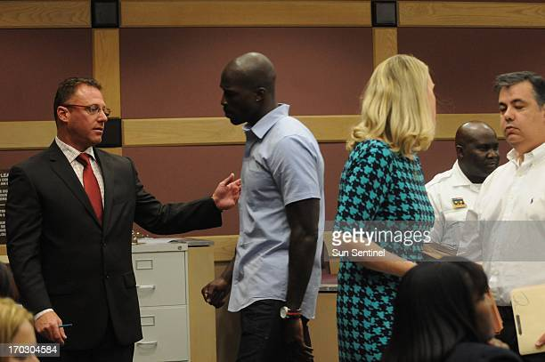 Lawyer Adam Swickle left guides his client former Miami Dolphins wide receiver Chad Johnson out of court for a 15minutebreak after Broward Circuit...
