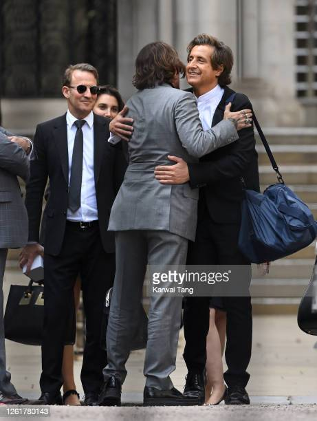 Lawyer Adam Waldman , Johnny Depp and David Sherbourne QC depart the Royal Courts of Justice, the Strand on July 28, 2020 in London, England. The...