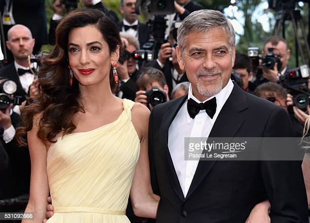 Lawyer Amal Clooney and actor George Clooney attend a screening of 'Money Monster' at the annual 69th Cannes Film Festival at Palais des Festivals on...