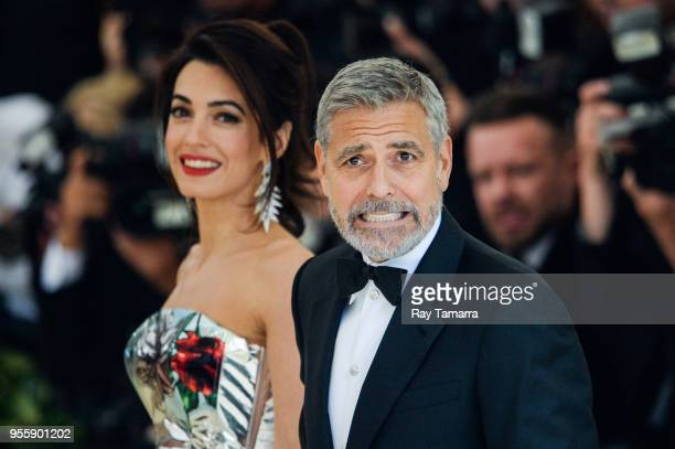Lawyer Amal Clooney and actor George Clooney enter the Heavenly Bodies Fashion The Catholic Imagination Costume Institute Gala at The Metropolitan...