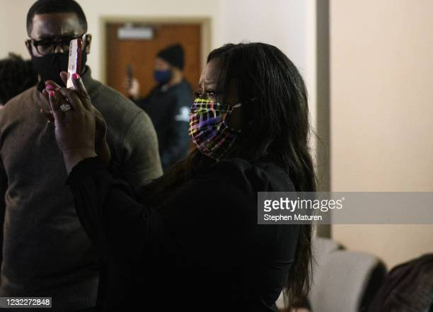 Lawyer and activist Nekima Levy Armstrong reacts as she watches the body camera footage of the killing of 20-year-old Daunte Wright as it played...