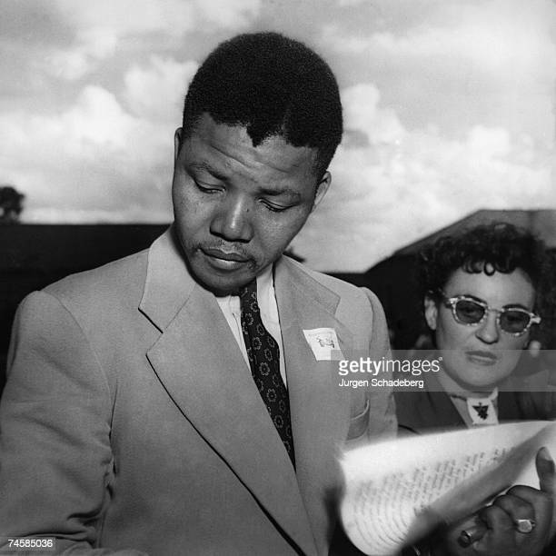 Lawyer and antiapartheid activist Nelson Mandela with fellow activist Ruth First at an African National Congress conference in Bloemfontein South...