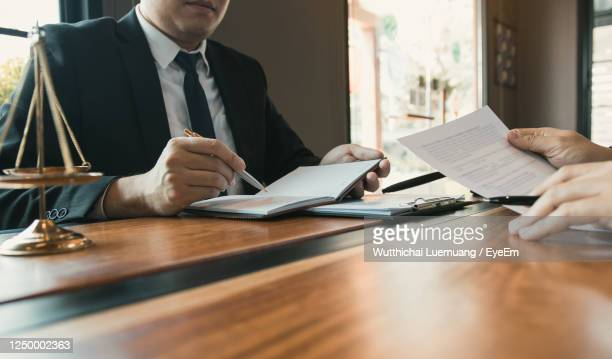 lawyer and customer in office - court room stock pictures, royalty-free photos & images