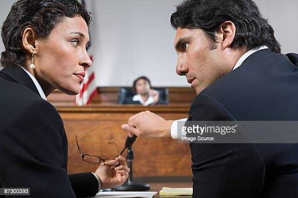 A lawyer and defendant talking