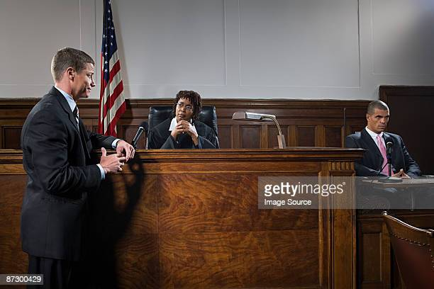 a lawyer and judge talking - courtroom stock pictures, royalty-free photos & images