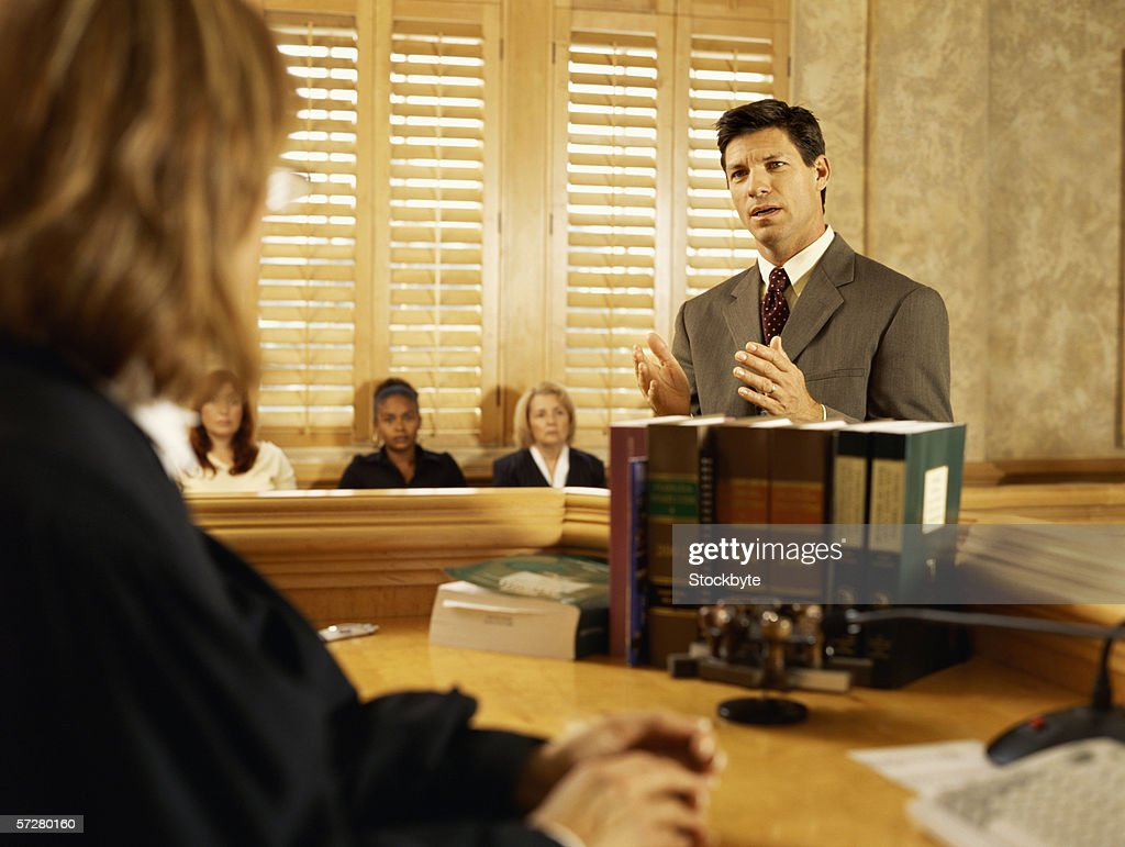 Lawyer approaching the judge : Stock Photo