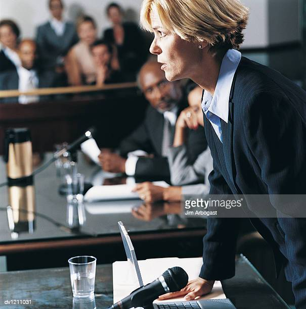 lawyer arguing her case in front of a jury in a courthouse - 法律関係の職業 ストックフォトと画像
