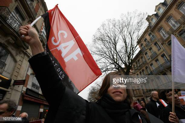 A lawyer brandishes a flag of the French syndicate of Lawyers Lawyers counsels and magistrates gathered in front of the Toulouse' courthouse for a...