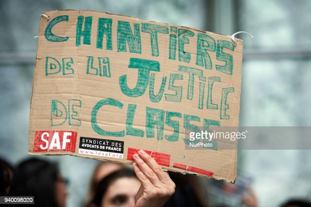 A lawyer brandishes a placard reading 'Work site of Class Justice' The French Bar Association all lawyers' unions all magistrates' unions called all...