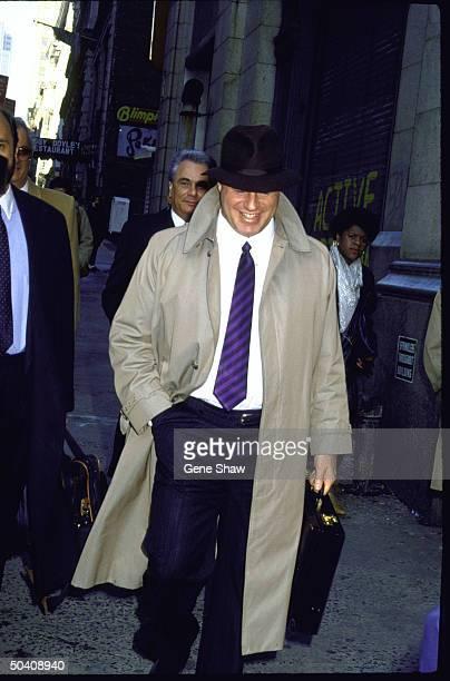 Lawyer Bruce Cutler walking in front of his client mafia boss John Gotti