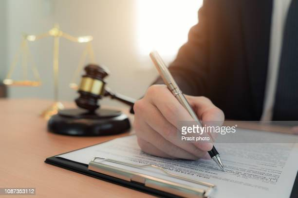 lawyer businessman working and notary signs the documents at office. consultant lawyer, justice and law ,attorney, court judge, concept. - legislation stock pictures, royalty-free photos & images