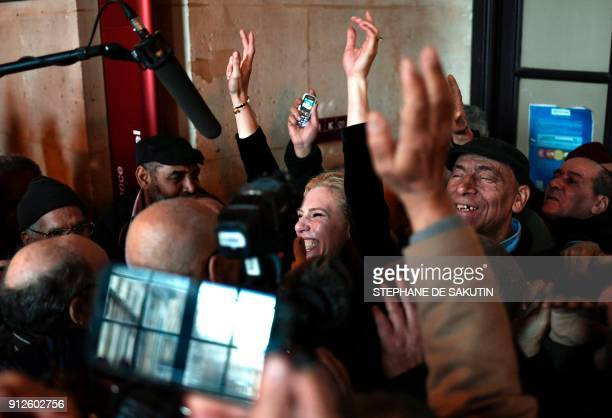 Lawyer Clelie de Lesquen-Jonas celebrates at the Court of Appeal in Paris on January 31, 2018 after former workers won in a discrimination claim made...